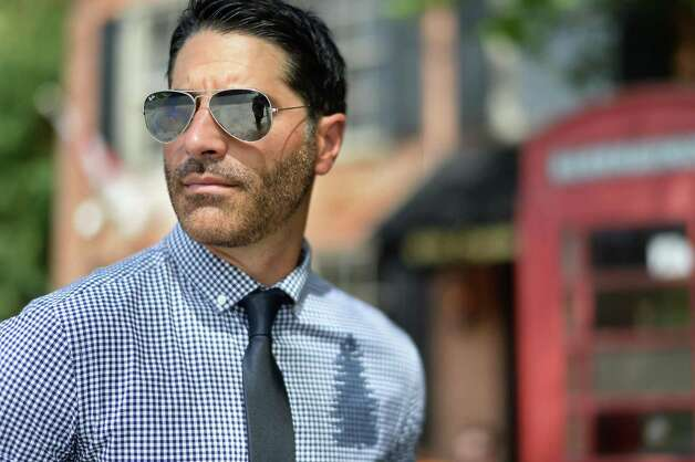 Matt Baumgartner outside his Olde English Pub on Broadway Friday May 29, 2015 in Albany, NY. Matt is wearing Ray Ban aviator sunglasses and a Howes & Baum shirt with a Kenneth Cole tie.  (John Carl D'Annibale / Times Union) Photo: John Carl D'Annibale / 00031984C