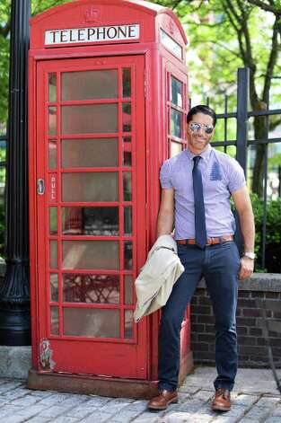 Matt Baumgartner outside his Olde English Pub on Broadway Friday May 29, 2015 in Albany, NY. Matt is wearing Ray Ban aviator sunglasses, a Howes & Baum shirt with a Kenneth Cole tie, J Crew pants, a Zara belt, Alden shoes and a Rolex watch.   (John Carl D'Annibale / Times Union) Photo: John Carl D'Annibale / 00031984C
