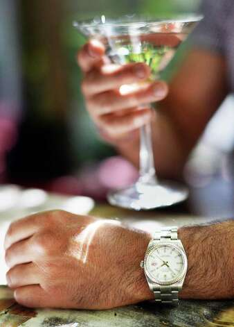 Matt Baumgartner wears a Rolex watch at the outside courtyard bar of his Olde English Pub on Broadway Friday May 29, 2015 in Albany, NY.   (John Carl D'Annibale / Times Union) Photo: John Carl D'Annibale / 00031984C