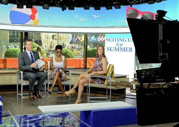 Co-anchors Willie Geist, left, and Tamron Hall talk with local fashion designer Jene Luciani of Niskayuna, right, on the set of The Today Show on Wednesday, June 10, 2015 in New York, N.Y. Luciani had models show some swim wear. (Lori Van Buren / Times Union) Photo: Lori Van Buren / 00031899A