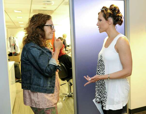 Local fashion designer Jene Luciani of Niskayuna, right, talks to a wardrobe person in the green room before appearing on The Today Show on Wednesday, June 10, 2015 in New York, N.Y. (Lori Van Buren / Times Union) Photo: Lori Van Buren / 00031899A