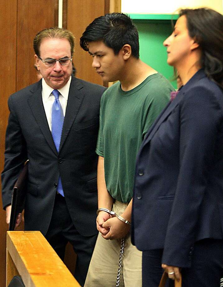 Adrian Jerry Gonzalez, center, is flanked by public defender Larry Biggam and attorney Leila Sayar as they enter the courtroom Thursday, July 30, 2015 where his arraignment was delayed in Santa Cruz, Calif.  Gonzalez charged with murder, kidnapping and rape in the death of 8-year-old Madyson Middleton, in an artists' complex in the California beach town. (Dan Coyro/Santa Cruz Sentinel via AP)     MANDATORY CREDIT Photo: Dan Coyro, Associated Press