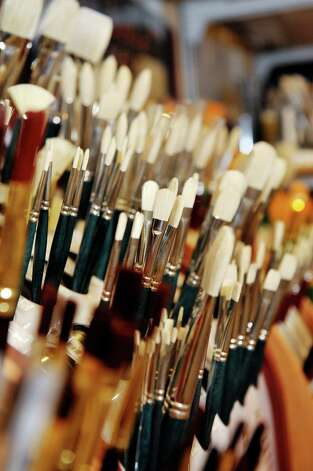 A view of paint brushes in the the art supplies section inside the Spotty Dog Books & Ale store on Warren St. on Thursday, June 25, 2015, in Hudson, N.Y.   (Paul Buckowski / Times Union) Photo: PAUL BUCKOWSKI / 00032353A