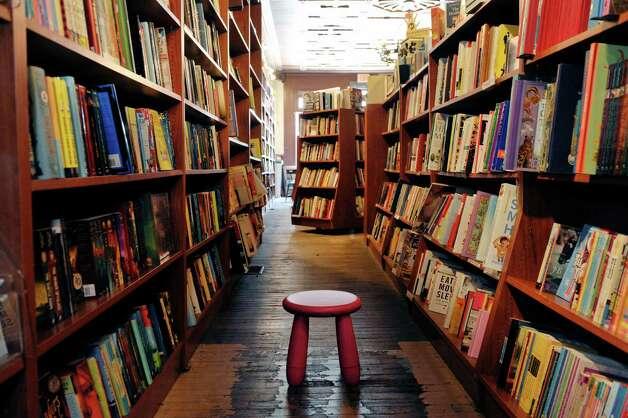 A view looking down the book shelves inside the Spotty Dog Books & Ale store on Warren St. on Thursday, June 25, 2015, in Hudson, N.Y.   (Paul Buckowski / Times Union) Photo: PAUL BUCKOWSKI / 00032353A