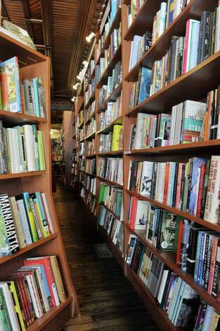 A view looking along the book shelves inside the Spotty Dog Books & Ale store on Warren St. on Thursday, June 25, 2015, in Hudson, N.Y.   (Paul Buckowski / Times Union) Photo: PAUL BUCKOWSKI / 00032353A