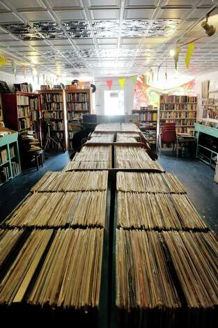 A view of the cases filled with records inside the John Doe Records store on Warren St. on Thursday, June 25, 2015, in Hudson, N.Y.  (Paul Buckowski / Times Union) Photo: PAUL BUCKOWSKI / 00032353A