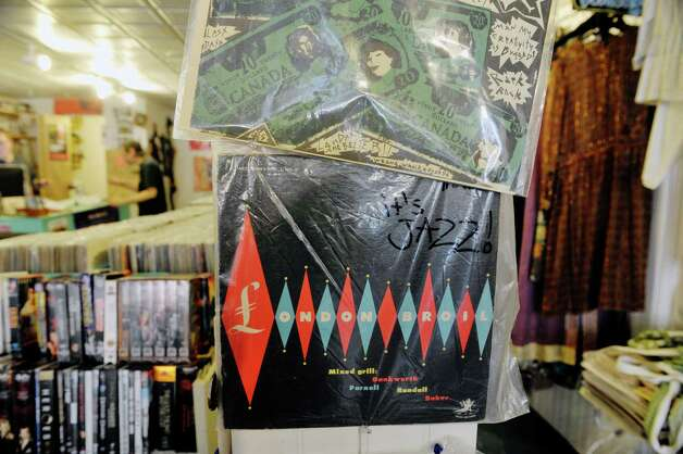 A view of records for sale hanging on the wall inside the John Doe Records store on Warren St. on Thursday, June 25, 2015, in Hudson, N.Y.  (Paul Buckowski / Times Union) Photo: PAUL BUCKOWSKI / 00032353A