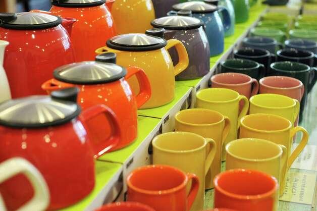 A view of tea pots and mugs for sale inside the Verdigris Art and Tea shop on Warren St. on Thursday, June 25, 2015, in Hudson, N.Y.    (Paul Buckowski / Times Union) Photo: PAUL BUCKOWSKI / 00032353A