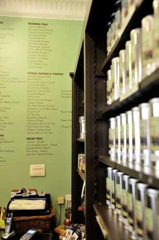 A view a board listing the different teas for sale inside the Verdigris Art and Tea shop on Warren St. on Thursday, June 25, 2015, in Hudson, N.Y.    (Paul Buckowski / Times Union) Photo: PAUL BUCKOWSKI / 00032353A