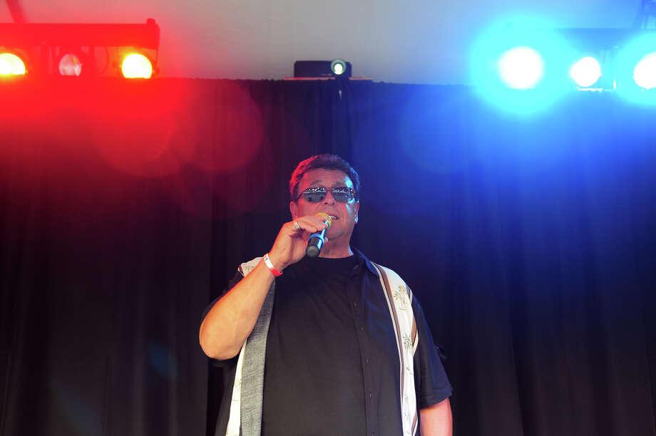 Mark Lanzieri sings popular Italian songs during Holy Rosary Parish Church's Festa! 2014 Italian Festival in Ansonia. Photo: Christian Abraham / Christian Abraham / Connecticut Post
