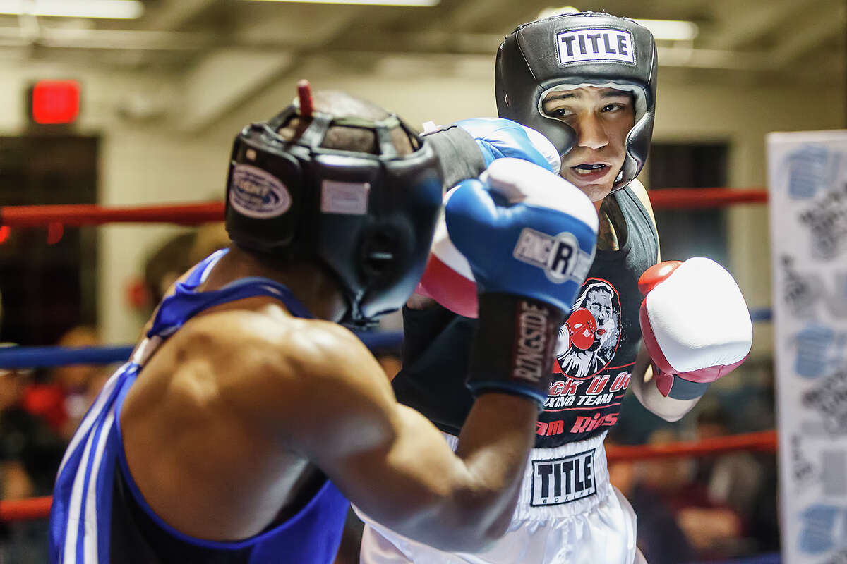 Daniel Baiz, boxing with Knock-U-Out, looks for an opening in the USAF's James Beck's defense during their Open Welter Weight bout on opening night of the 2013 San Antonio Regional Golden Gloves tournament at Woodlawn Gym on Tuesday, Feb. 19, 2013. Baiz came away with a 5-0 decision.