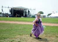 Six-year-old Zoe Moore, of Fairfield, runs through the field in front of the band shell on the opening day of the 20th annual Gathering of the Vibes music festival Thursday, July 30, 2015 at Seaside Park in Bridgeport, Conn.