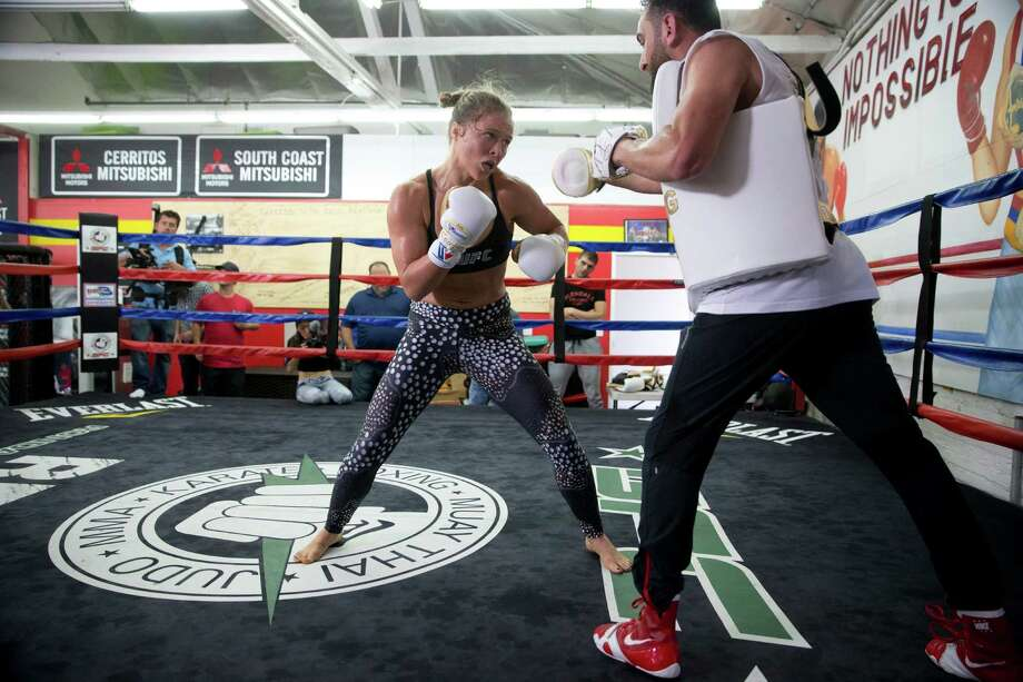 Mixed martial arts fighter Ronda Rousey, left, trains with trainer Edmond Tarverdyan at Glendale Fighting Club, Wednesday, July 15, 2015, in Glendale, Calif. Rousey, the UFC bantamweight champion, will return to the octagon against Brazils unbeaten Bethe Correia at UFC 190 in Rio de Janeiro on Aug. 1. Photo: Jae C. Hong /Associated Press / AP