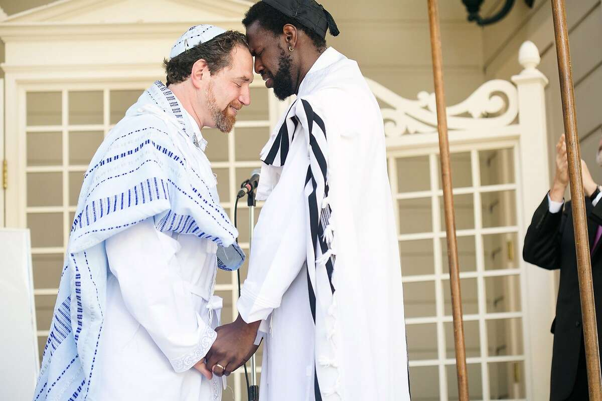 Mike and Anthony wed June 21 in Oakland. Mike is a rabbi and activist. Anthony, is a former opera singer turned Yiddish singer. They met online in New York.