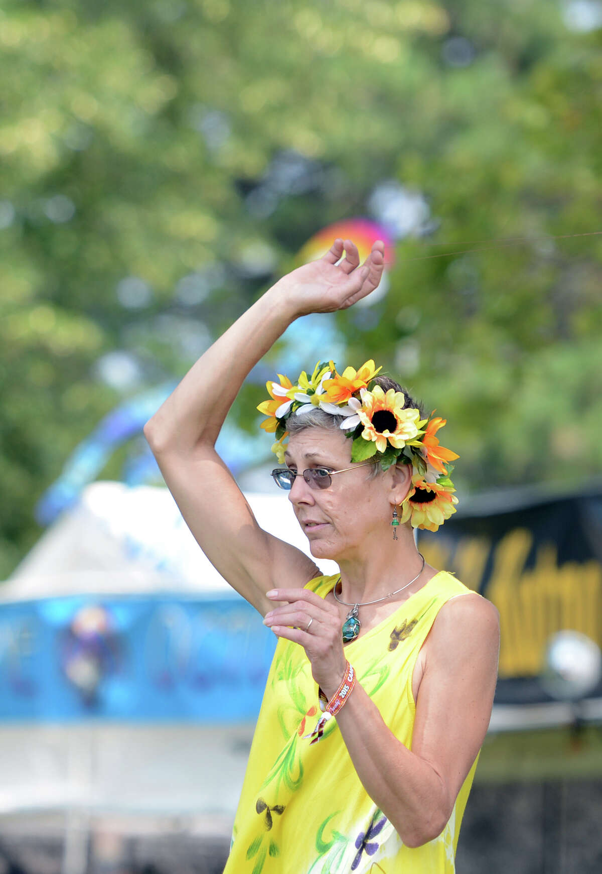 Tara Prindle, of Vernon, dances on the opening day of the 20th annual Gathering of the Vibes music festival Thursday, July 30, 2015 at Seaside Park in Bridgeport, Conn.