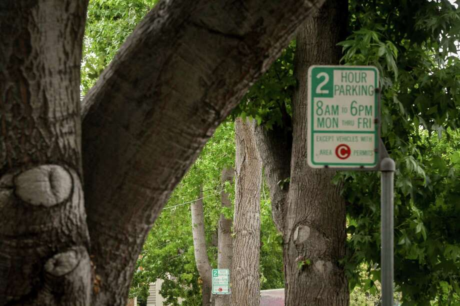 An area C permit sign in a residential neighborhood off Claremont Avenue warns of a 2 hour parking limit.  Photo: Sam Wolson / Special To The Chronicle / ONLINE_YES