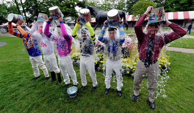 Five jockeys and a former jockey took part in the ALS awareness ice pour in the paddock of the Saratoga Race Course Friday afternoon Aug. 15, 2014, in Saratoga Springs, N.Y.   The participants from left to right are: John Velazquez, Mike Luzzi, Jose Ortiz, Manuel Franco, Irad Ortiz Jr. and former jockey and present television personality Richard Migliore. (Skip Dickstein/Times Union archive) Photo: SKIP DICKSTEIN