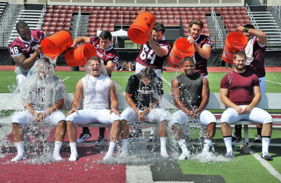 Union football captains, from left, Nick Pierce, Andrew Luzzi, quarterback Connor Eck, Darnell Thomas and Dylan Schuck take the ice bucket challenge during Union College Football media day Tuesday August 26, 2014, in Schenectady, NY.  (John Carl D'Annibale / Times Union archive) Photo: John Carl D'Annibale / 00028248A