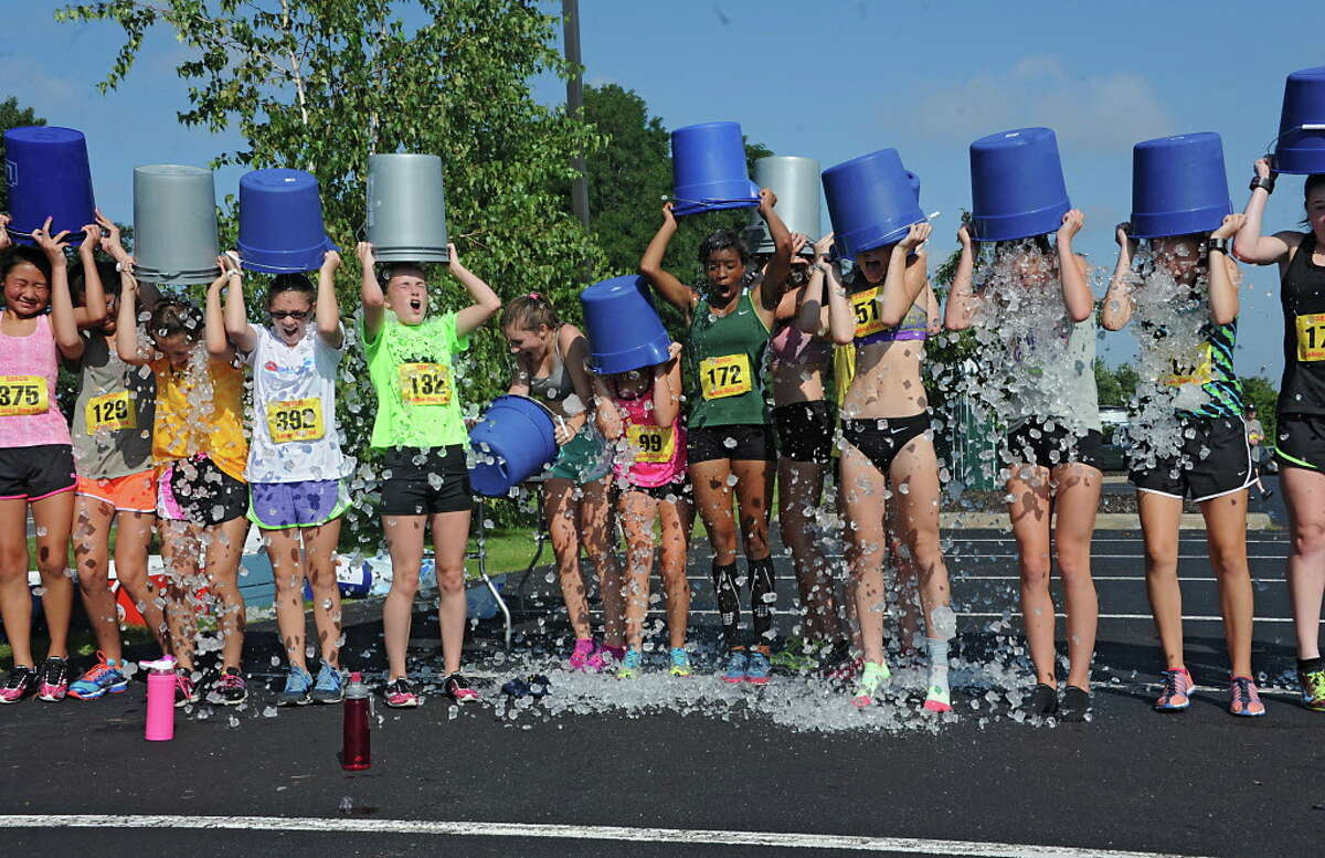 Members of the Colonie girls cross country team do the ALS ice bucket challenge after finishing the SEFCU Labor Day 5k Race on Monday, Sept. 1, 2014 in Albany, N.Y. The girls challenged their coach Frank Myers to do the challenge also. (Lori Van Buren / Times Union archive)