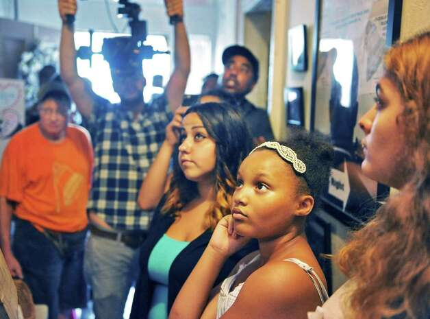 Participants listen as fellow students make their presentations inside the historic Stephen and Harriet Myers Residence during the Annual Young Abolitionist Teen Scholars? Institute Open House Thursday July 30, 2015 in Albany, NY.  (John Carl D'Annibale / Times Union) Photo: John Carl D'Annibale / 10032837A
