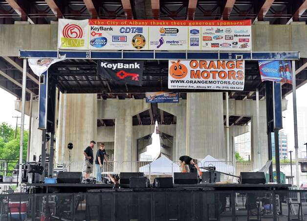 Crews erect a stage under 787 at the Corning Preserve Boat Launch for tonight's Alive at Five concert featuring RaeLynn & Big Sky Country due to the threat of inclement weather Thursday July 30, 2015 in Albany, NY.   (John Carl D'Annibale / Times Union) Photo: John Carl D'Annibale