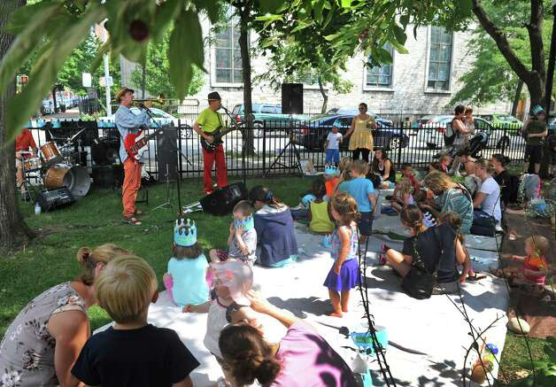 Children and adults groove to the sound of the band Dog On Fleas as part of the Barker Park kid's Summer Series  on Thursday July 30, 2015 in Troy, N.Y. (Michael P. Farrell/Times Union) Photo: Michael P. Farrell