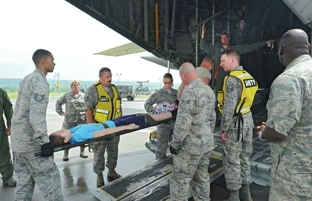 Civil Air Patrol members acting as patients are loaded on to a C-130 airplane during an exercise at the Stratton Air National Guard Base on Thursday, July 30, 2015 in Glenville, N.Y.  The annual exercise required as part of the federal National Disaster Medical System in which hospital patients and nursing home residents are evacuated from disaster areas to regions in which they can be cared for in government and civilian hospitals and health care facilities. The exercise involves simulated patients being moved from civilian facilities to Stratton Air National Guard Base. (Lori Van Buren / Times Union) Photo: Lori Van Buren / 10032829A