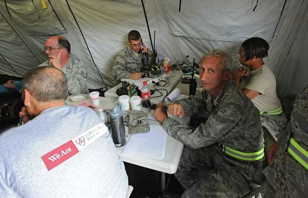 A communications table is seen in a tent during an exercise at the Stratton Air National Guard Base on Thursday, July 30, 2015 in Glenville, N.Y.  The annual exercise required as part of the federal National Disaster Medical System in which hospital patients and nursing home residents are evacuated from disaster areas to regions in which they can be cared for in government and civilian hospitals and health care facilities. The exercise involves simulated patients being moved from civilian facilities to Stratton Air National Guard Base. (Lori Van Buren / Times Union) Photo: Lori Van Buren / 10032829A
