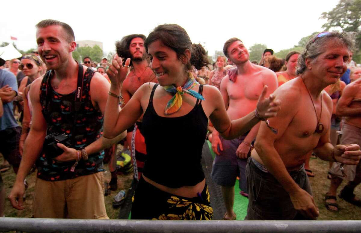 Cassandra Parisi, of Vernon, Conn., dances to the music of the Ryan Montbleau Band at the Gathering of the Vibes at Seaside Park in Bridgeport, Conn., on Thursday July 30, 2015.