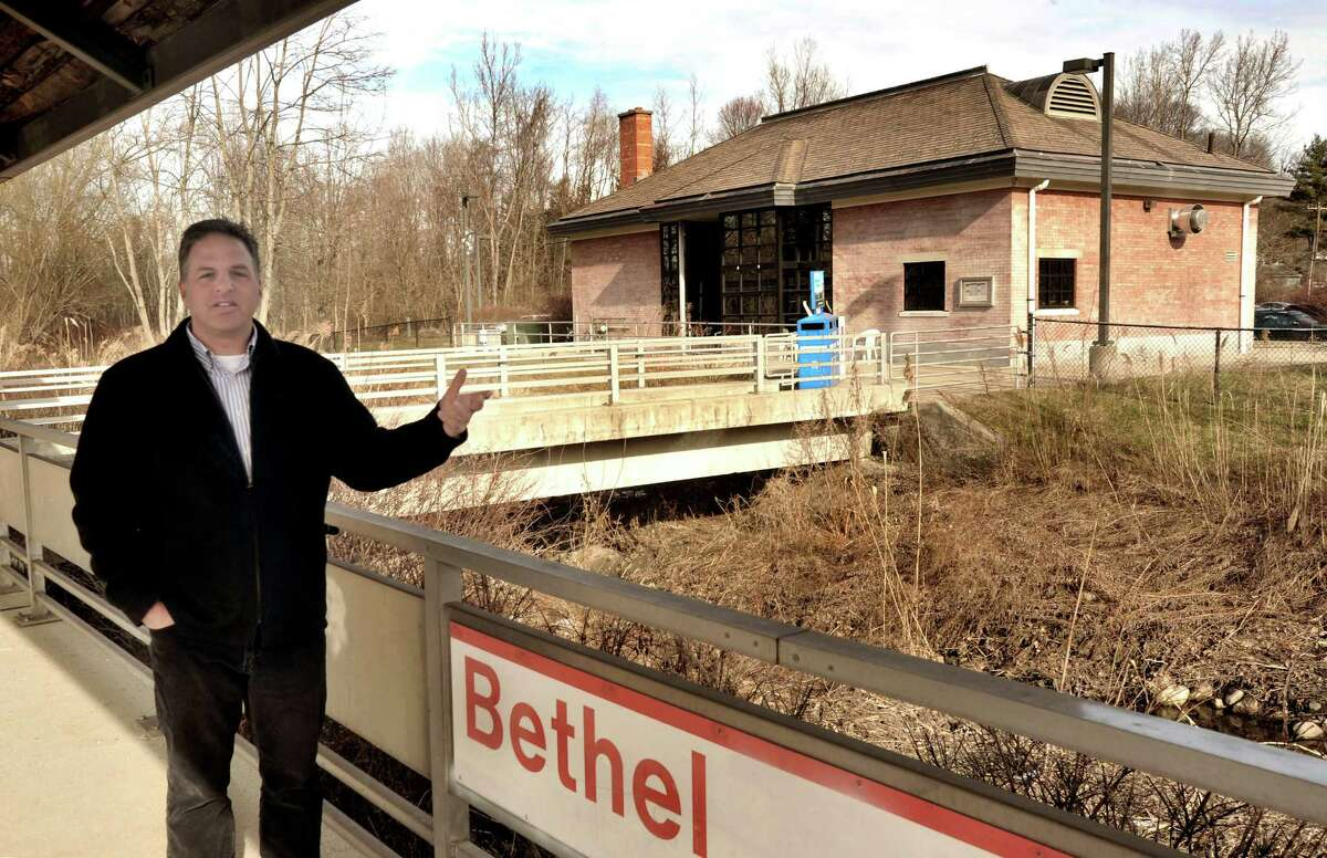 Standing on the train platform, City Planner Steve Palmer points out the area proposed near the Bethel Train Station for redevelopment as a transit oriented.