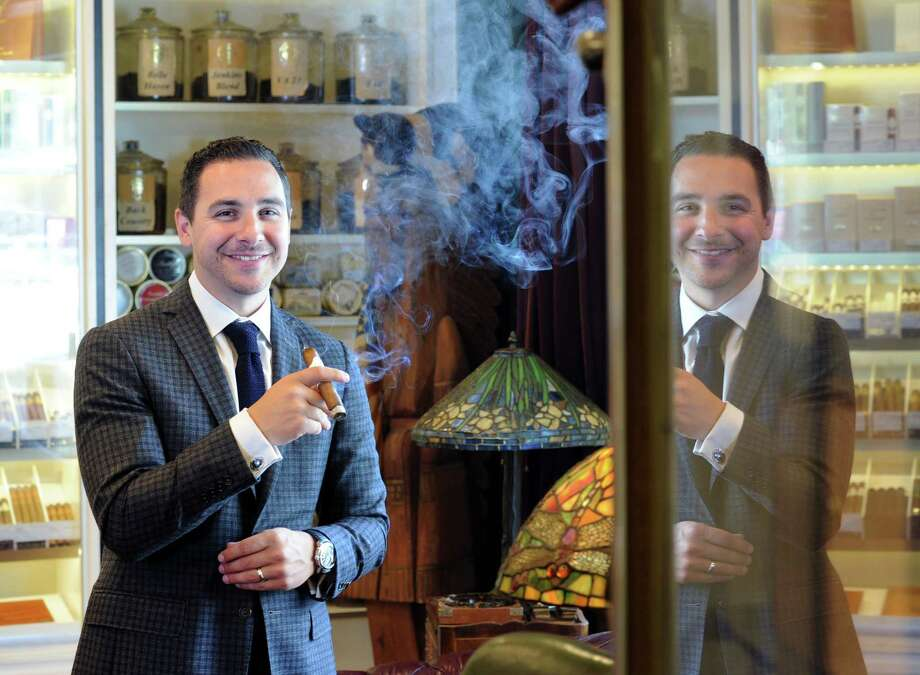 Michael Cafagno, owner of the Tobacconist of Greenwich, in his shop at 8 Havemeyer Place in Greenwich on Tuesday. The store was recently awarded the Appointed Merchant of the Year from Davidoff of Geneva for the fourth year running. Photo: Bob Luckey Jr. / Hearst Connecticut Media / Greenwich Time