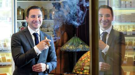 Michael Cafagno, owner of the Tobacconist of Greenwich, in his shop at 8 Havemeyer Place in Greenwich on Tuesday. The store was recently awarded the Appointed Merchant of the Year from Davidoff of Geneva for the fourth year running.