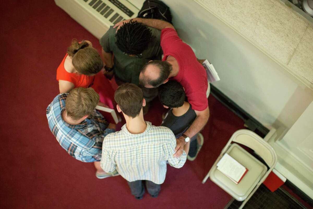 A group gathers in prayer during a service at First Presbyterian Church in Chattanooga, Tenn., where five servicemen were in a bloody rampage. Calls for gun control in the aftermath of the shooting represent a knee-jerk, liberal reaction, according to a reader.