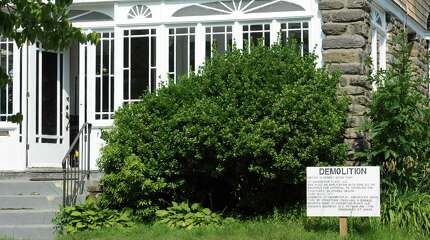 A demolition sign on the front lawn of 131 Havemeyer Place in Central Greenwich, Conn., Wednesday, July 29, 2015.