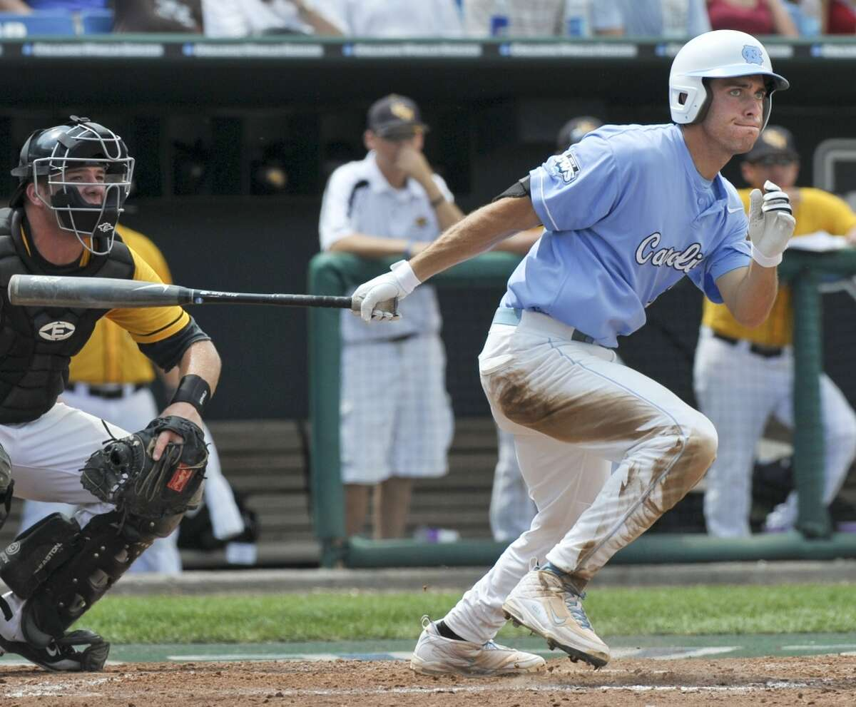 North Carolina's Dustin Ackley hits a base hit as Southern Mississippi catcher Travis Graves looks on during the fifth inning of an NCAA College World Series baseball game, in Omaha, Neb., Tuesday, June 16, 2009.