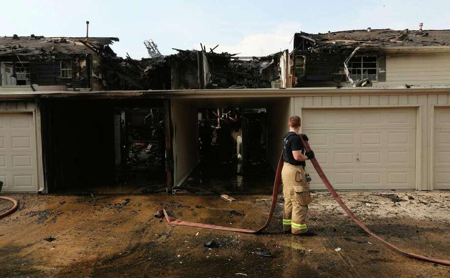 Three alarm fire damages townhomes san antonio express news for San antonio home alarm