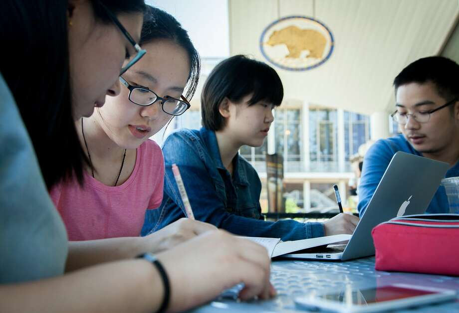 L-R: International students Yijie Sha, 21, from Beijing, China, Zhiying Deng, 20, from Jiangxi, China, Xiaoyu Zhang, 21, from Zhejiang, China and Sion Kim, 24, from Seoul, South Korea, study for their business class, Thursday, July 30, 2015, at the University of California, Berkeley. Photo: Santiago Mejia, Special To The Chronicle