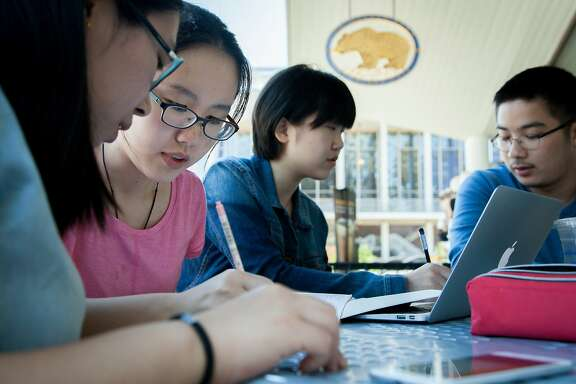 L-R: International students Yijie Sha, 21, from Beijing, China, Zhiying Deng, 20, from Jiangxi, China, Xiaoyu Zhang, 21, from Zhejiang, China and Sion Kim, 24, from Seoul, South Korea, study for their business class, Thursday, July 30, 2015, at the University of California, Berkeley.