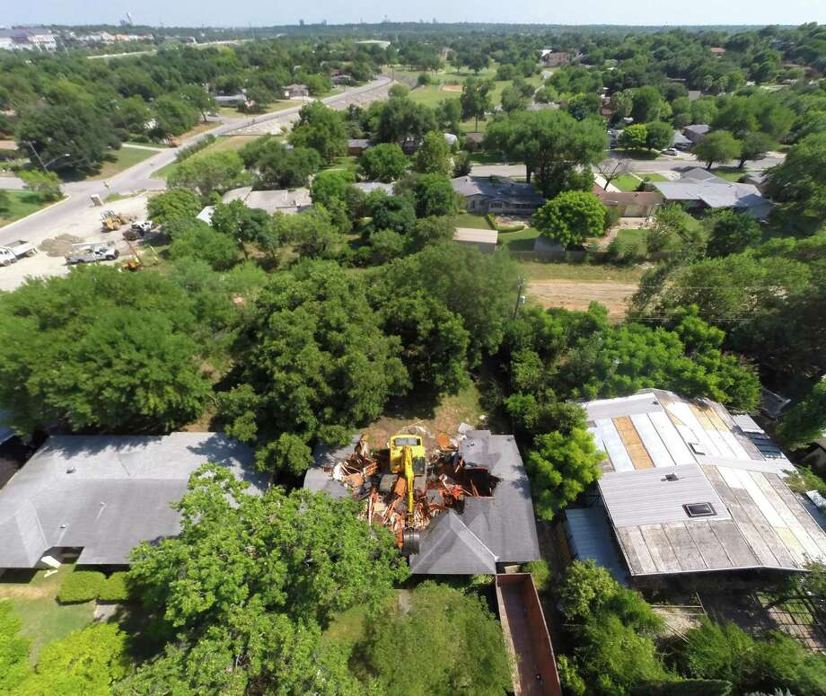 A home in the 200 block of Barbara, between McCullough Avenue and Skipper Drive is demolished as seen from a remte controlled quadcopter Thursday afternoon July 30, 2015 as part of a flood control project. The house is one of a number of homes that backs up to a drainage ditch that is being improved to help control flooding in the area. Photo: William Luther, Staff / San Antonio Express-News / © 2015 San Antonio Express-News