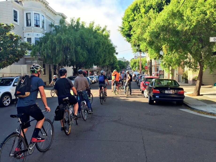 A group of bicyclists rides single file along Steiner Street on Wednesday as part of a protest over enforcement of traffic laws on a popular bike route. Photo: Kale Williams / Kale Williams / The Chronicle / ONLINE_YES