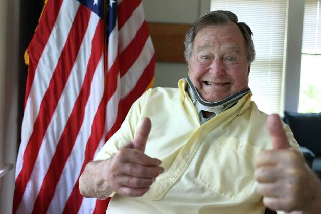 In this Thursday, July 30, 2015, photo provided by the Office of George H. W. Bush, former President George H.W. Bush wears a neck brace at his summer home in Kennebunkport, Maine. The 91-year-old tweeted the photo showing him in the brace and giving two thumbs up Thursday. Bush fractured a bone in his neck when fell there on July 15. Doctors are letting the fractured vertebra heal on its own over the next several months.  Photo: Associated Press / Office of George H. W. Bush