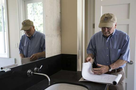 Architect Roger Kohler looks at the blueprint of a basement beneath a newly built home in Palo Alto, Calif. on Thursday, July 30, 2015.