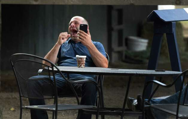 Trainer John Terranova yawns broadly this morning after a long morning of training his stable July 30, 2015 at the Saratoga Race Course in Saratoga Springs, N.Y.    (Skip Dickstein/Times Union) Photo: SKIP DICKSTEIN