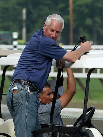 Trainer Todd Pletcher watches his charges on the main track this morning during training hours July 30, 2015 at the Saratoga Race Course in Saratoga Springs, N.Y.    (Skip Dickstein/Times Union) Photo: SKIP DICKSTEIN