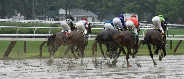 After the first race of the day was cancelled due to the heavy rains the second race of the day shows the sloppy condition of the main track Thursday afternoon July 30, 2015, at the Saratoga Race Course in Saratoga Springs, N.Y.    (Skip Dickstein/Times Union) Photo: SKIP DICKSTEIN