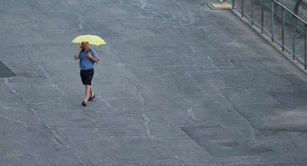 A rain storm doesn't deter the loyal race fan from coming to the track Thursday afternoon July 30, 2015, at the Saratoga Race Course in Saratoga Springs, N.Y.    (Skip Dickstein/Times Union) Photo: SKIP DICKSTEIN