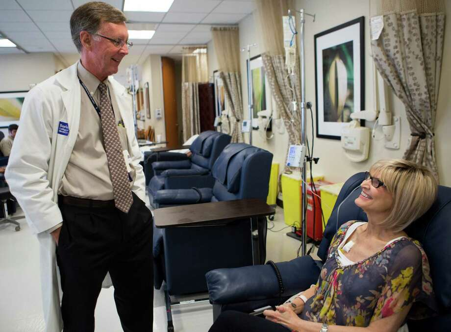 Dr. Kent Osborne, director of Baylor's cancer center, visits patient Carole Roush. He says the center's new designation will improve patient access to state-of-the-art clinical care. Photo: Marie D. De Jesus, Staff / © 2015 Houston Chronicle