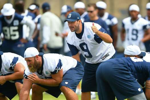 Dallas Cowboys quarterback Tony Romo (9) takes a snap as he runs plays with the office during Dallas Cowboys' NFL training camp, Thursday, July 30, 2015, in Oxnard, Calif. (AP Photo/Gus Ruelas) Photo: Gus Ruelas, FRE / Associated Press / FR157633 AP