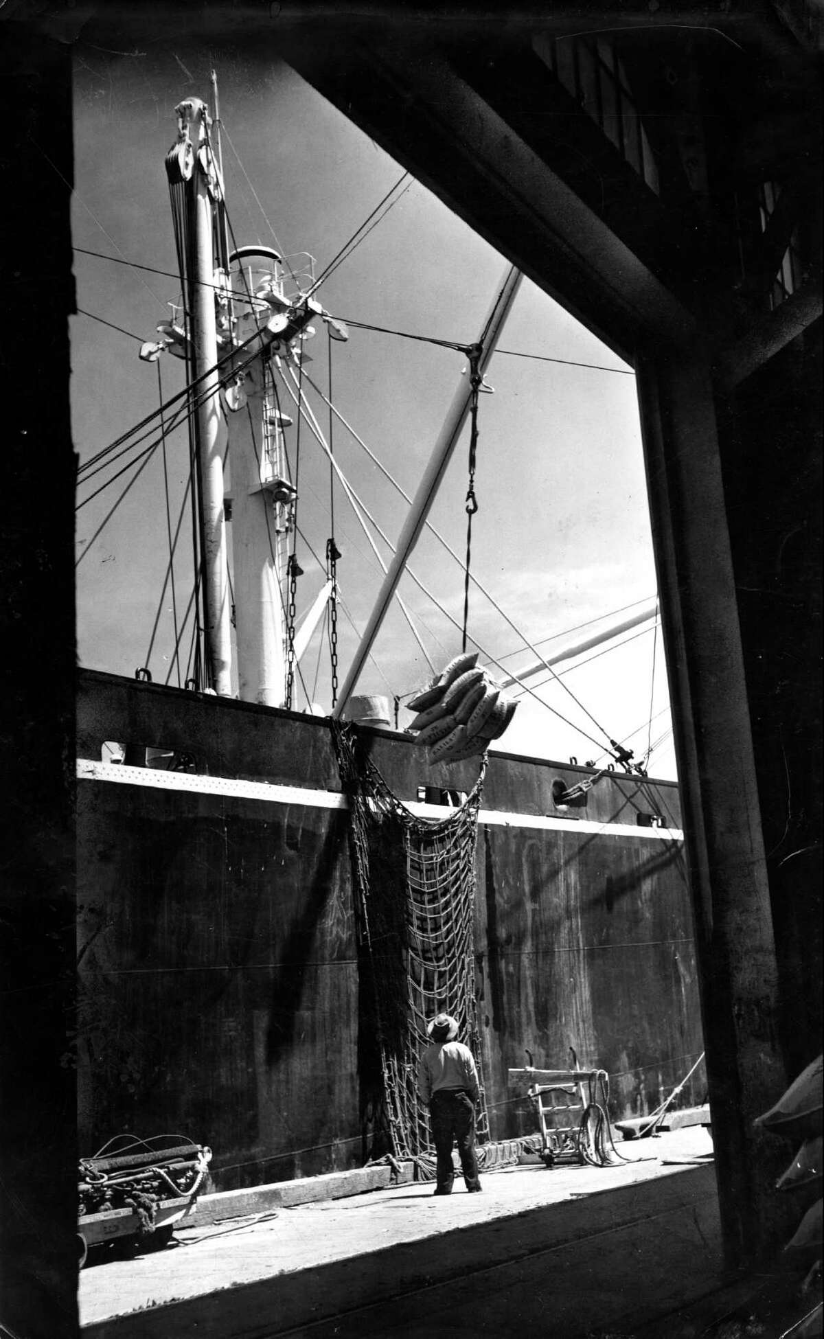 May 12, 1954: ship being loaded with cargo on the waterfront photo ran 05/18/1954 world trade section p. 1