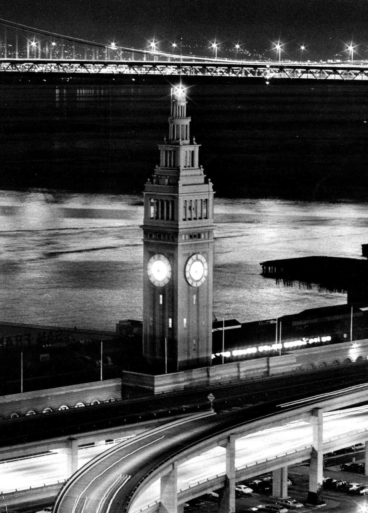 The Ferry Building rises above the old Embarcadero Freeway in the early 1970s. The freeway came down and the former transportation hub was reinvented as a destination for tourists and gourmets after 1989's Loma Prieta earthquake.